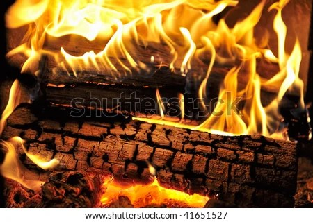 Dancing flames in a real woodburning fire in a woodburning stove. - stock photo
