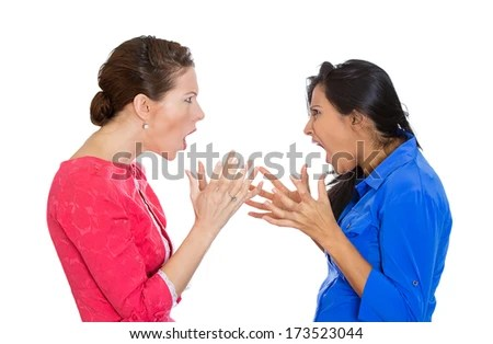 Closeup portrait of two mad angry women with bad attitudes getting into an argument about to fight, isolated on white background. Interpersonal conflict. Negative emotions facial expression feeling - stock photo