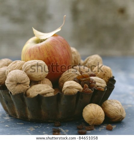 stock photo : Apple, walnuts and raisins