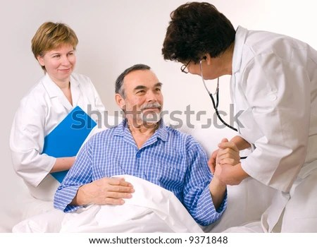 stock photo : Two doctors with a patient