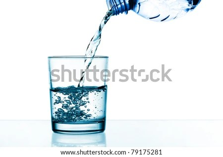 stock photo : Drinking water is poured from a bottle into a glass