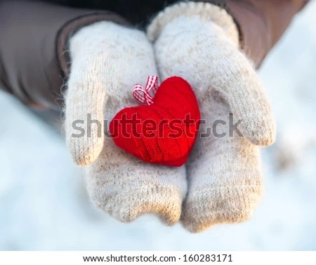 Read heart  in white warm wool gloves  - stock photo