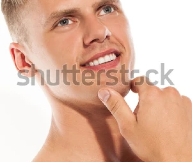 Portrait Of Handsome Naked Caucasian Guy Over White Background