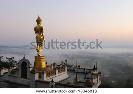 Buddha standing on a mountain Wat Phra That Khao Noi, Nan Province, Thailand - stock photo