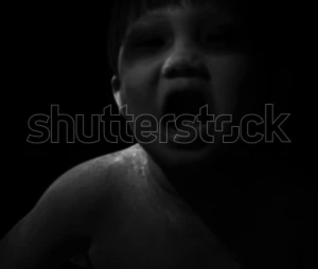 Black And White View Asian Toddler On White Face Makeup Is Painted Black Around The