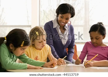 https://i1.wp.com/image.shutterstock.com/display_pic_with_logo/85699/85699,1263490265,1/stock-photo-teacher-helping-students-in-school-classroom-horizontally-framed-shot-44513719.jpg
