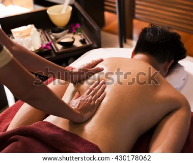 Asian Man Getting Massage In Spa