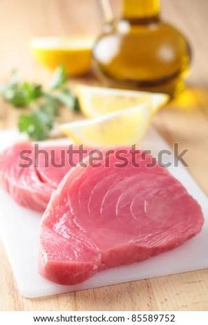 stock photo : Raw tuna steaks on a cutting board