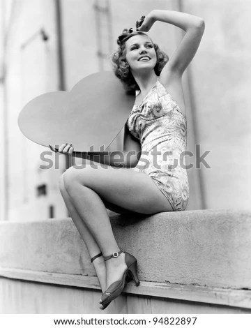 stock photo : Woman holding a large valentine