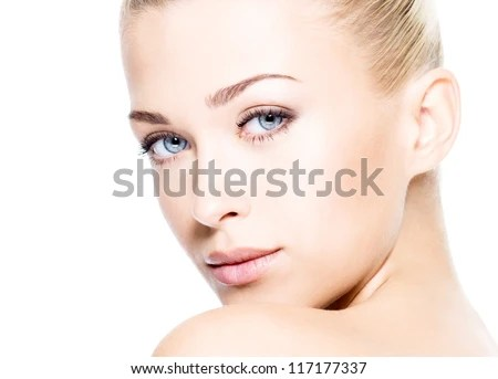 Portrait of beautiful young blond woman with clean face.  High key shot. - stock photo