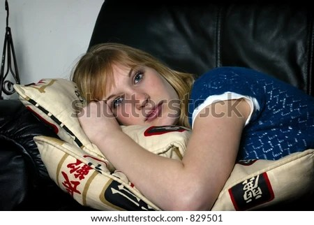 pretty blonde laying on sofa - stock photo