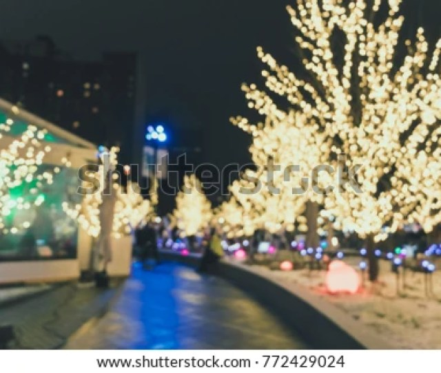Abstract Blurred People Celebrating For Christmas In A Night Event With Background Wallpaper Concept