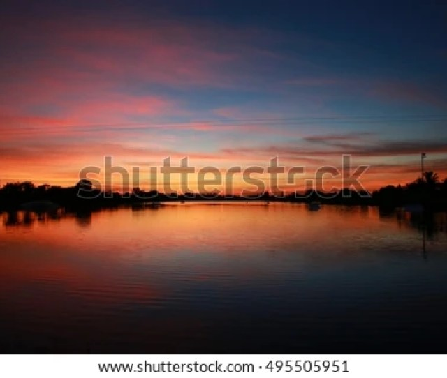 After Sunset On The Ski Rixen Lake With Reddish Orange Clouds At Quiet Waters Park