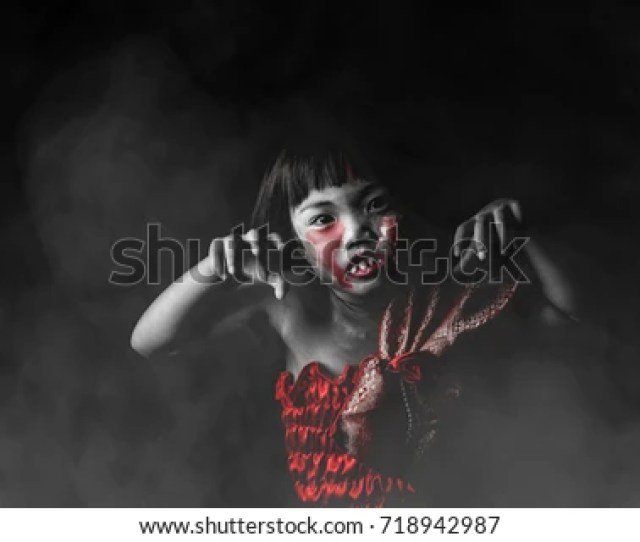 Asian Kid In Thai Dress With White Face Makeup Is Painted Red Eye Look Like Bleeding