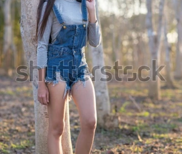 Asian Teens Girl Standing In The Park Relaxing