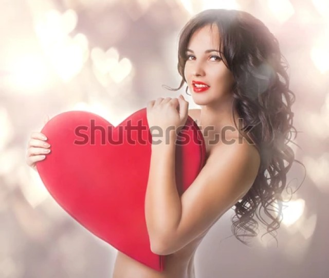 Beautiful Nacked Girl With Big Heart In Hands Portrait In Studio