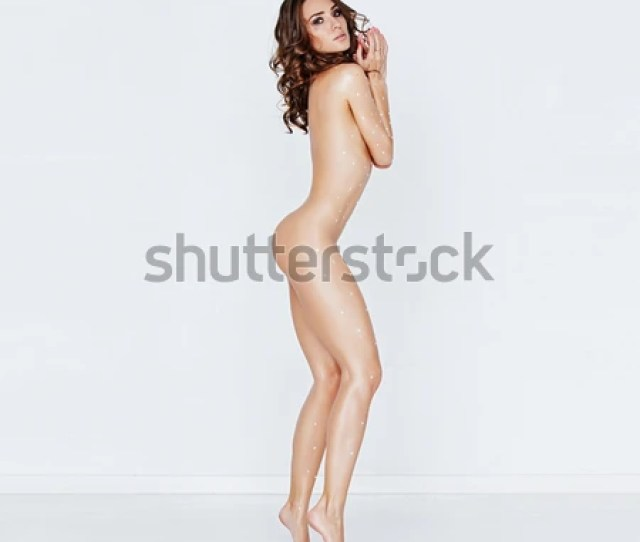 The Beautiful Naked Girl Stand On Tiptoe Sideways The Body Is Stuck Round By Jewels