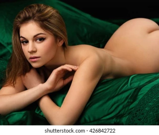 Beautiful Young Woman Lies On A Bed Made Of Silk