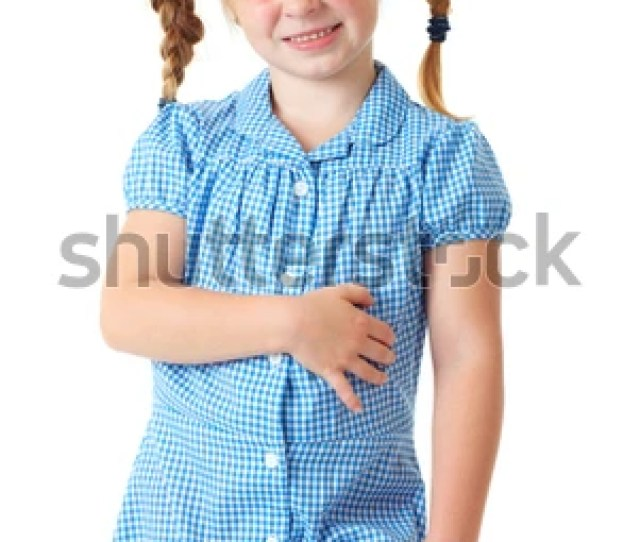 Blonde Schoolgirl In Blue Dress And Pigtails Makes Some Funny Faces Shoot Over White