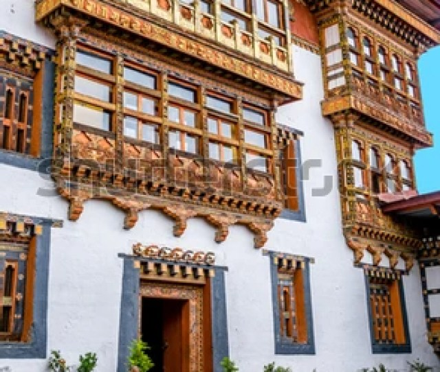 Buddhist Monk In Front Of The Talo Goemba Monastery In Bhutanese Temple Bhutan Decorated