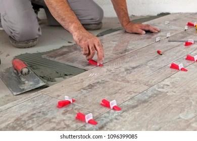 https www shutterstock com image photo ceramic tiles tiler placing level position 1096399085