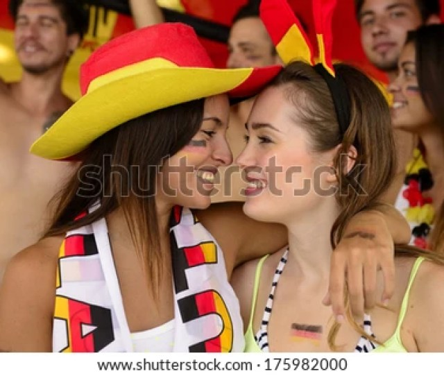 Cheerful Couple Of German Lesbian Soccer Fans Almost Kissing Celebrating Victory