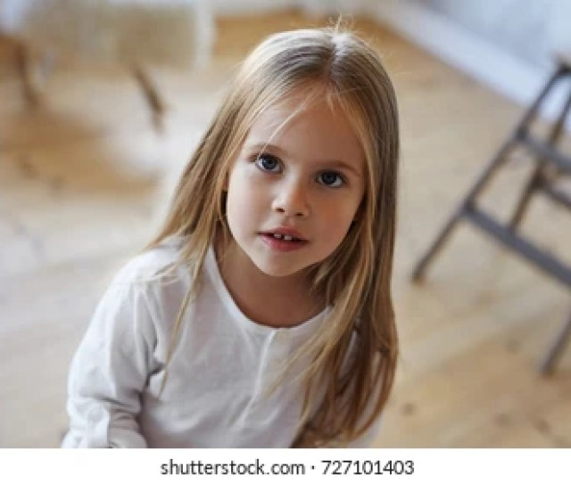 Close Up Portrait Of Beautiful Pretty 5 Year Old Caucasian Girl With Big Eyes And