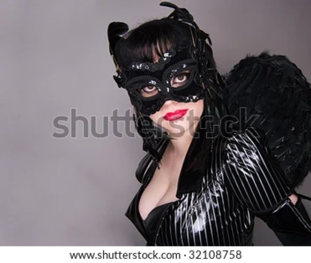 Evil Angel In Black With Masquerade Mask And Feathered Wings