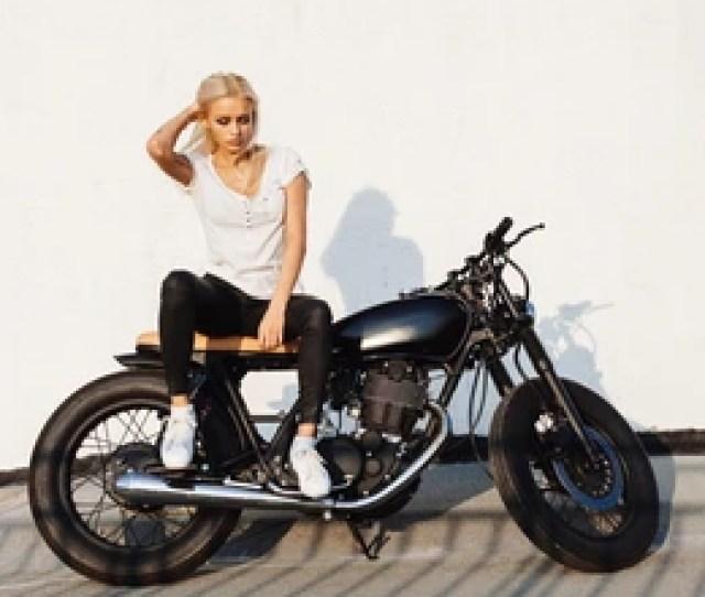 Fashion Female Biker Girl Young Blonde Woman In Leather Jacket Sitting On Vintage Custom Motorbike