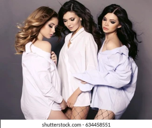 Fashion Studio Photo Of Gorgeous Sexy Girls With Beautiful Hairstyle Wearing White Shirts