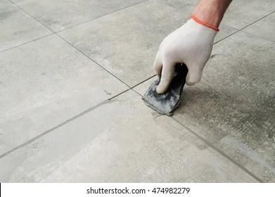 https www shutterstock com image photo grouting ceramic tiles tilers filling space 474982279