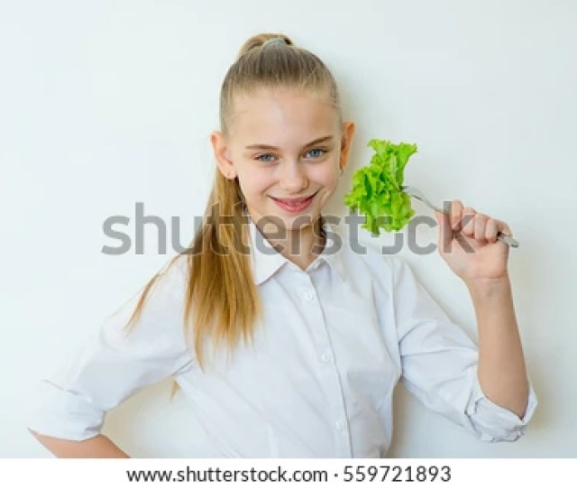 Happy Fitness Girl Holding Fork With Lettuce Isolated