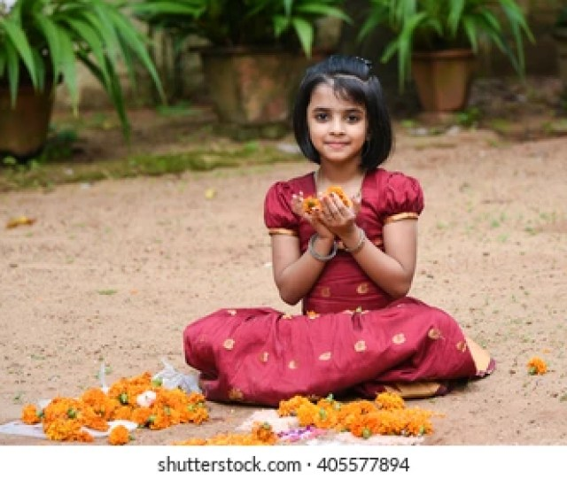 Happy Smiling Playful Young Indian South Indian Girl Wearing Traditional Dress Holding Making Flower