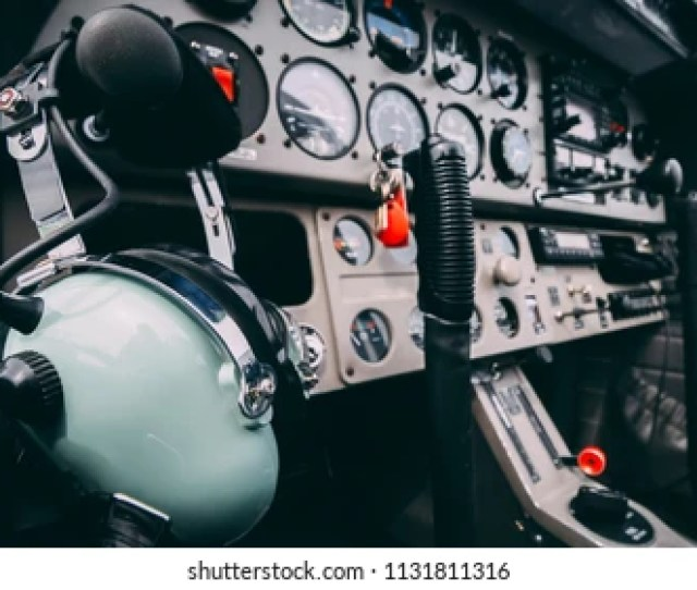 Headset Hanging On The Throttle Control Of A Small Plane Taken At An Aerodrome In