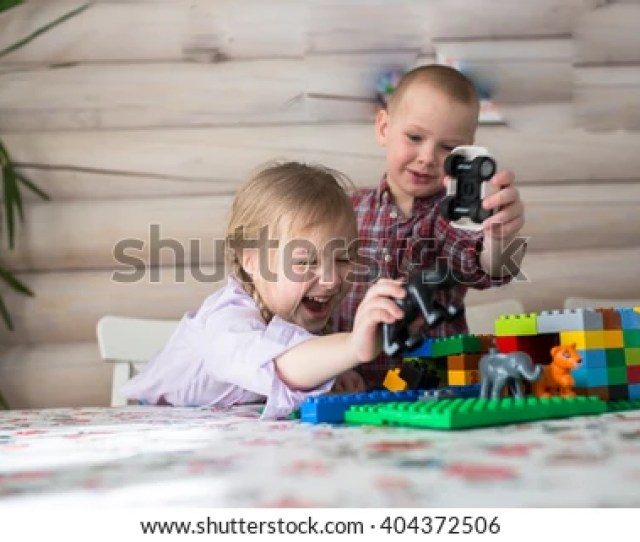 Kids Siblings Brother And Sister Playing In The Constructor Casual Lifestyle Photo Series In Real