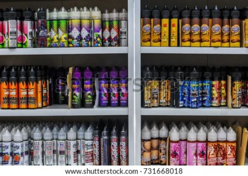 KUALA LUMPUR, MALAYSIA - SEPTEMBER 27, 2017 : Various of vape juices on the shelf for sale in vape shop.