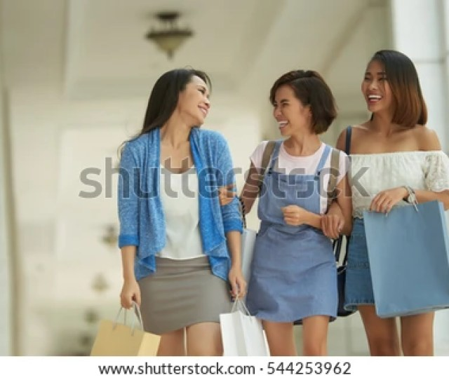 Laughing Asian Chicks With Shopping Bags