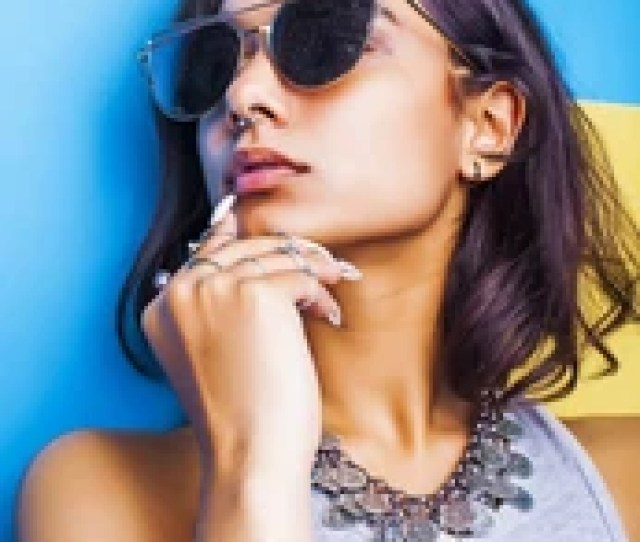 Lifestyle People Concept Young Pretty Smiling Indian Girl With Long Nails Wearing Lot Of Jewelry