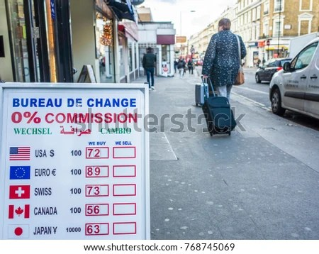 london november 2017 a currency exchange bureau de change board showing dollars euros and other currency values on a high street in bayswater london