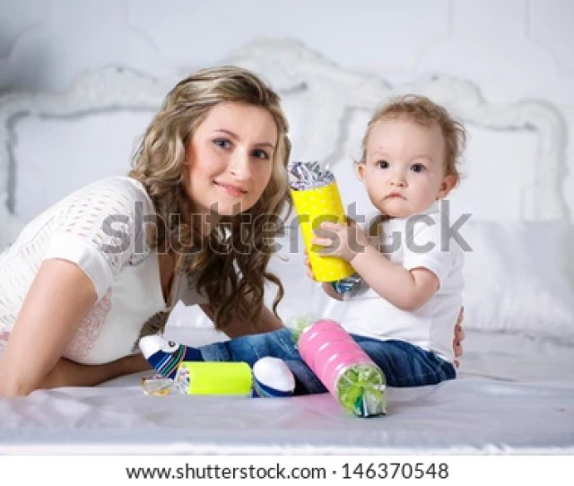 Mom With Her Son Beautiful Curly Haired Boy With A Big Candy In The