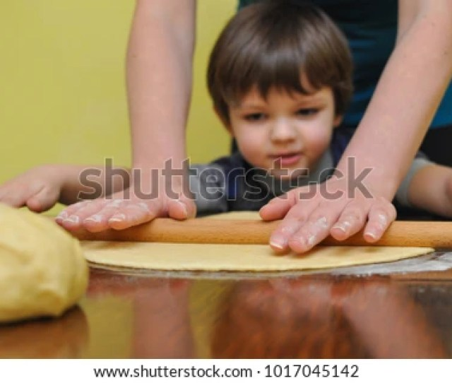Mom And Son Prepare Dough For A Homemade Strudel Making Domestic Cookies