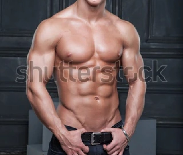 Muscular Young Naked Smiling Sexy Guy Posing In Jeans