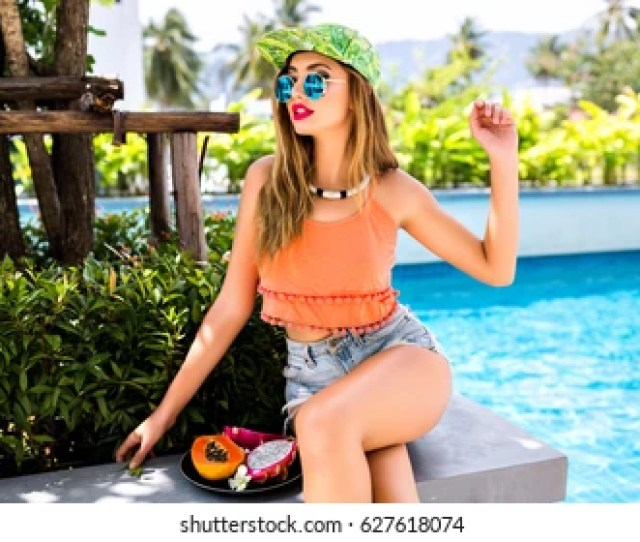 Outdoor Right Sunny Portrait Of Young Hipster Girl Having Fun At Hotel Pool Party