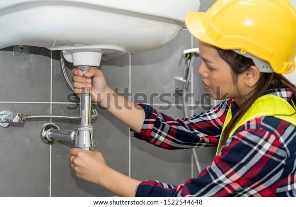 https www shutterstock com image photo plumber plumbing specialist fixing kitchen sink 1522544648