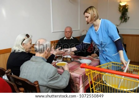 Image of: Pixoto Poor Old People Having Free Dinner Social Worker Giving Plate With Meal To An Old Shutterstock Poor Old People Having Free Dinner Stock Photo edit Now 1072550849
