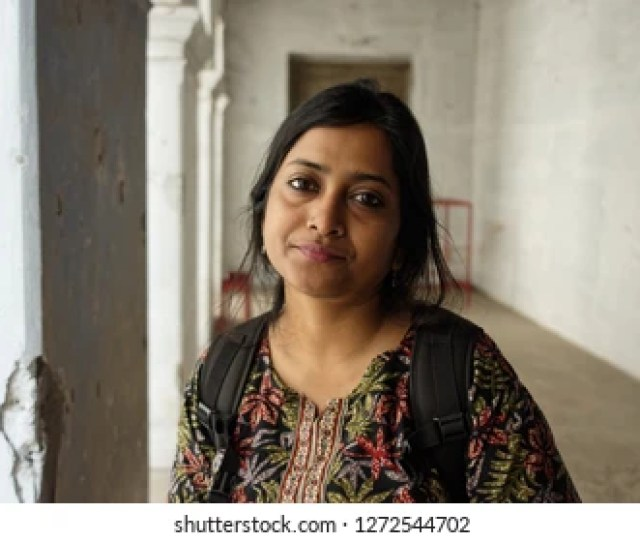 Portrait Of An Indian Bengali Young And Beautiful Lady Inside A Vintage Religious Building Indian