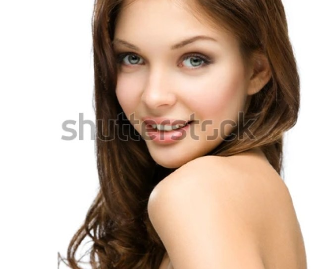 Portrait Of Nude Girl With Hair Ringlets Isolated On White Concept Of Beauty And