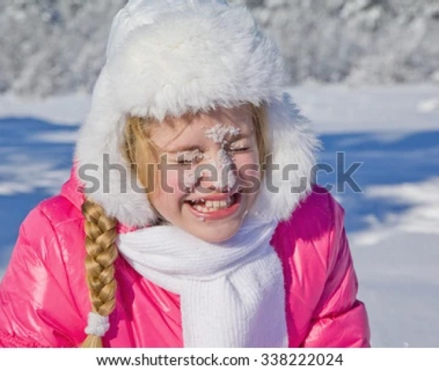 Portrait Smiling Girl Teen With Snow On Face