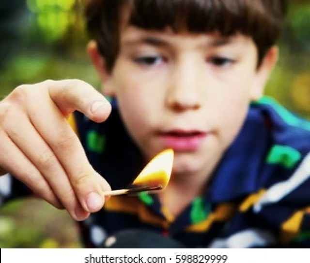 Preteen Handsome Boy Play With Fire Hold Match