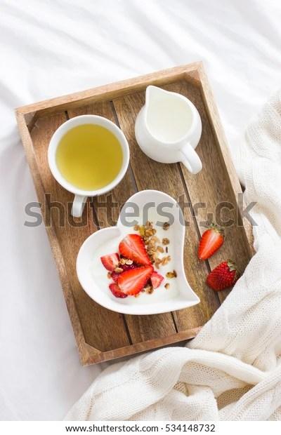 https www shutterstock com fr image photo romantic breakfast bed yogurt granola strawberry 534148732